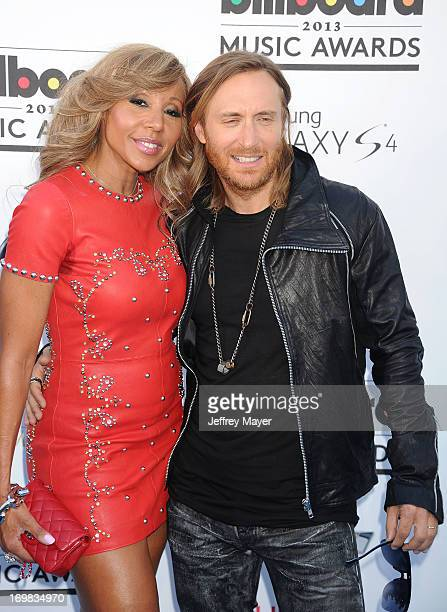 David Guetta and Cathy Guetta arrive at the 2013 Billboard Music Awards at the MGM Grand Garden Arena on May 19 2013 in Las Vegas Nevada