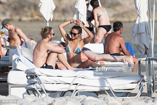 David Guetta and girlfriend enjoy a day at a beach club on July 6 2016 in Ibiza Spain