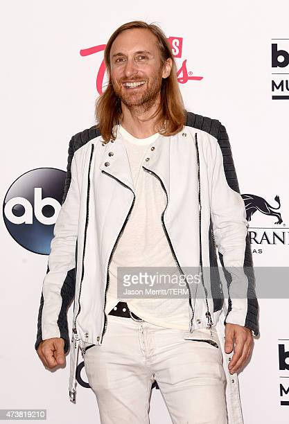 David Guetta poses in the press room during the 2015 Billboard Music Awards at MGM Grand Garden Arena on May 17 2015 in Las Vegas Nevada
