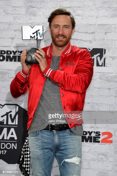 David Guetta poses with the Best Electronica award in the winner's room during the MTV EMAs 2017 held at The SSE Arena Wembley on November 12 2017 in...