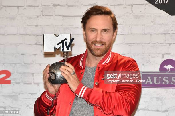 David Guetta poses with the Best Electronica award in the Winners Room during the MTV EMAs 2017 held at The SSE Arena Wembley on November 12 2017 in...
