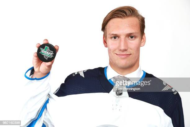 David Gustafsson poses after being selected 60th overall by the Winnipeg Jets during the 2018 NHL Draft at American Airlines Center on June 23 2018...