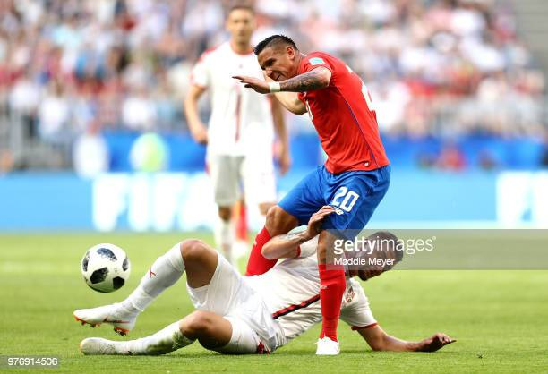 David Guzman of Costa Rica is tackled by Sergej MilinkovicSavic of Serbia during the 2018 FIFA World Cup Russia group E match between Costa Rica and...