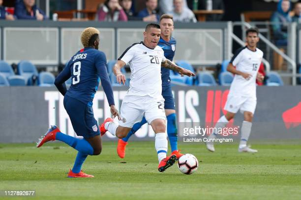 David Guzman of Costa Rica looks to pass the ball against the United States during their international friendly match at Avaya Stadium on February 2...