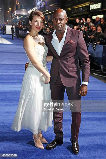 David Gyasi and Emma Gyasi attend the European Premiere of Interstellar at the Odeon Leicester Square on October 29 2014 in London England