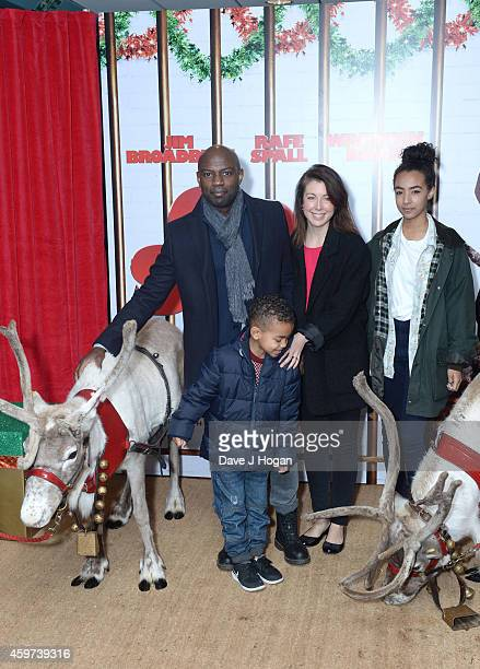 David Gyasi Emma Gyasi and their children attend the UK Premiere of Get Santa at Vue West End on November 30 2014 in London England