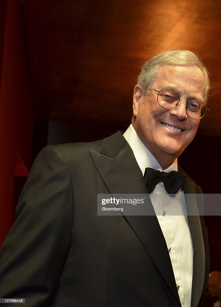 David H. Koch, executive vice president at Koch Industries Inc., poses for a photo during the opening night at the Metropolitan Opera in New York, U.S. on Monday, Sept. 26, 2011. Anna Netrebko sang in a new staging of Donizetti's opera about Anne Boleyn, whose beheading started a trend at the court of Henry VIII. Photographer: Amanda Gordon/Bloomberg via Getty Images