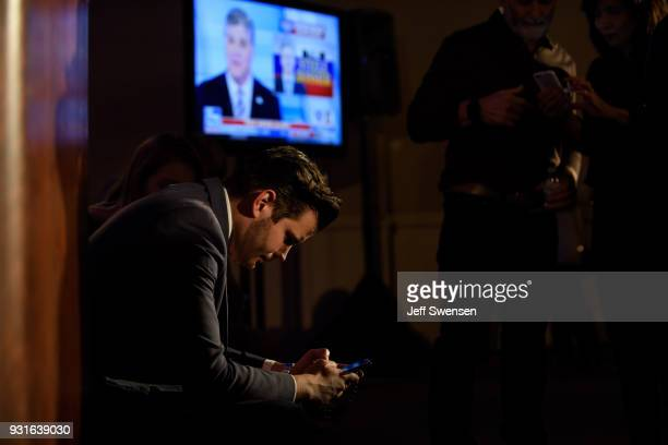 David Haas Director of Mission Advancement for Catholic Vote a SuperPAC checks early election results at an Election Night event for GOP PA...