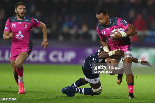 David Halaifonua of Gloucester is held up by the challenge of Yoan Tanga of Agen during the European Rugby Challenge Cup Pool 3 match between...
