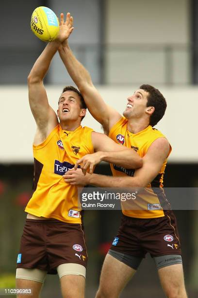 David Hale and Brent Renouf of the Hawks contest in the ruck during a Hawthorn Hawks AFL training session at Waverley Park on March 18 2011 in...