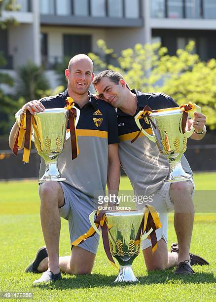 David Hale and Brian Lake of the Hawks pose with the 2013 2014 and 2015 Premiership Trophies during a Hawthorn Hawks AFL press conference at Waverley...