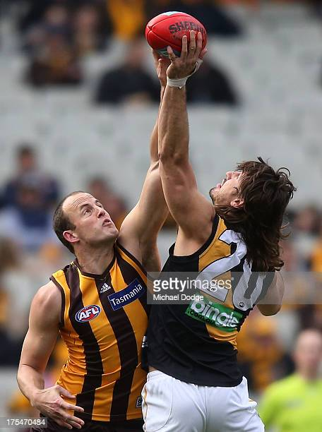David Hale of the Hawks and Ivan Maric of the Tigers contest for the ball during the round 19 AFL match between the Hawthorn Hawks and the Richmond...