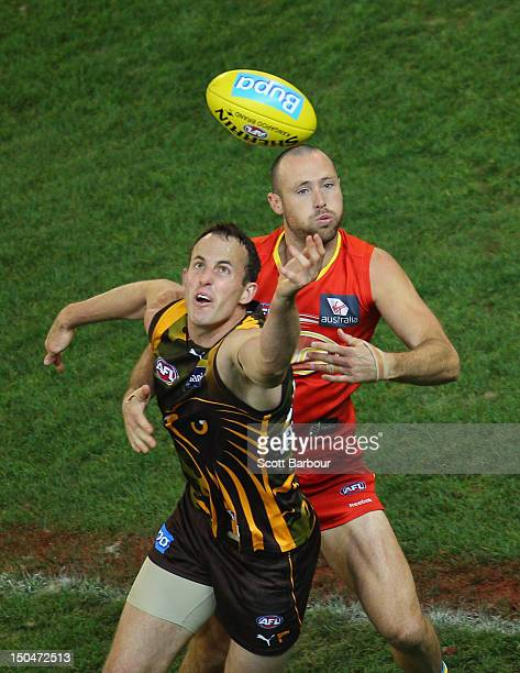 David Hale of the Hawks and Matthew Warnock of the Suns compete for the ball during the round 21 AFL match between the Hawthorn Hawks and the Gold...