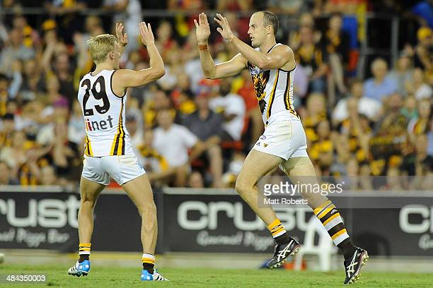 David Hale of the Hawks celebrates kicking a goal during the round four AFL match between the Gold Coast Suns and the Hawthorn Hawks at Metricon...