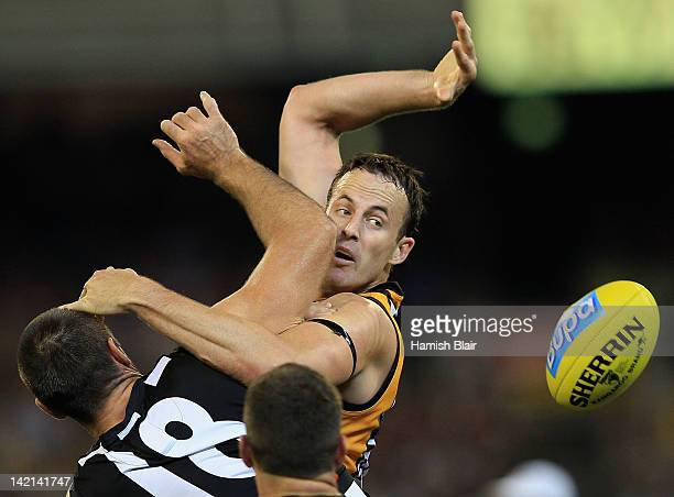 David Hale of the Hawks contests ruck against Darren Jolly of the Magpies during the round one AFL match between the Hawthorn Hawks and the...