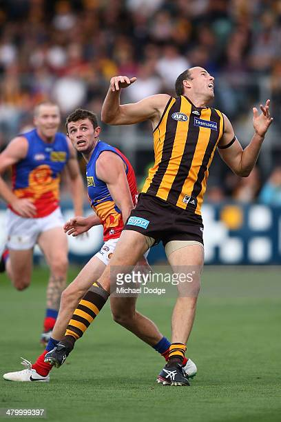 David Hale of the Hawks injures a left ankle after this contest with Pearce Hanley of the Lions during the round one AFL match between the Hawthorn...