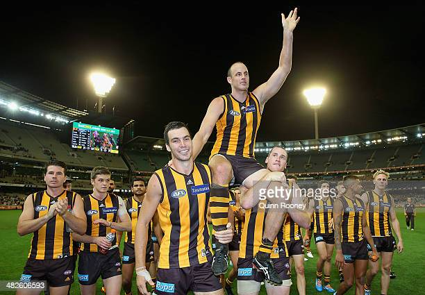 David Hale of the Hawks is cheered off the ground after playing his 200th game during the round three AFL match between the Hawthorn Hawks and the...