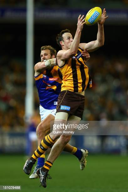 David Hale of the Hawks marks infront of Will Schofield of the Eagles during the round 23 AFL match between the Hawthorn Hawks and the West Coast...