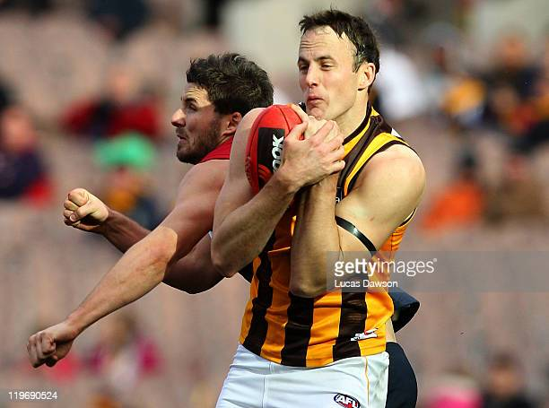 David Hale of the Hawks marks the ball during the round 18 AFL match between the Melbourne Demons and the Hawthorn Hawks at Melbourne Cricket Ground...