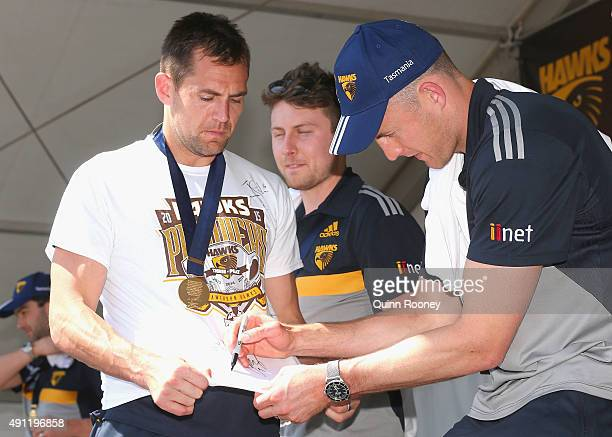 David Hale of the Hawks signs Luke Hodge's top during the Hawthorn Hawks AFL Grand Final fan day at Glenferrie Oval on October 4 2015 in Melbourne...