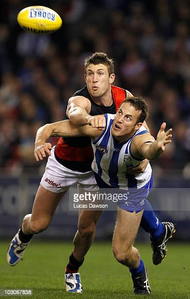 David Hale of the Kangaroos and Cale Hooker of the Bombers contests for a mark during the round 17 AFL match between the North Melbourne Kangaroos...