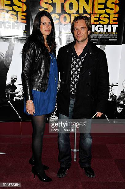 David Hallyday and Alexandra Pastor attend the premiere of 'Shine a Light' in Paris