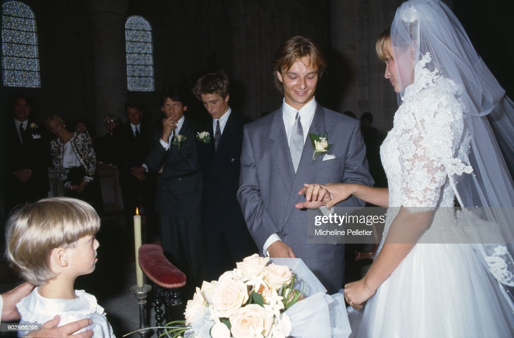 David Hallyday and Estelle Lefebure at the church on their wedding day, Saint Martin de Boscherville, France, 15th September 1989