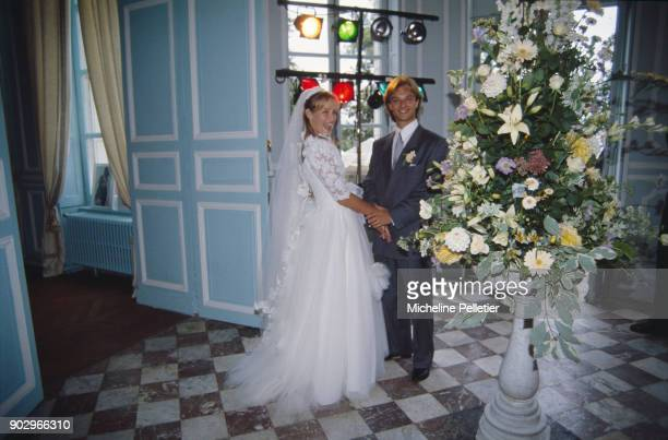 David Hallyday and Estelle Lefebure posing on their wedding day, Saint Martin de Boscherville, France, 15th September 1989