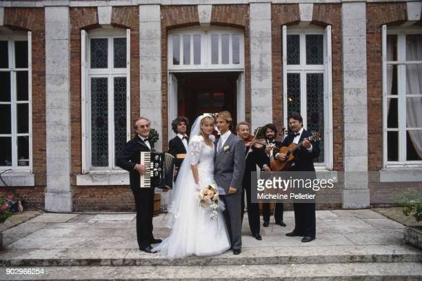 David Hallyday and Estelle Lefebure posing with an orchestra on their wedding day Saint Martin de Boscherville France 15th September 1989