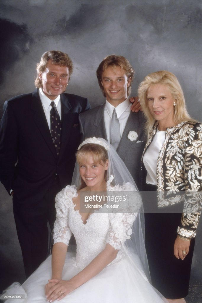 David Hallyday and Estelle Lefebure posing with Sylvie Vartan and Johnny Hallyday on their wedding day, Saint Martin de Boscherville, France, 15th September 1989