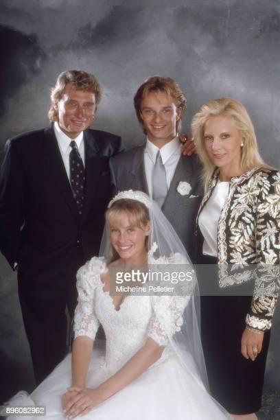 David Hallyday and Estelle Lefebure posing with Sylvie Vartan and Johnny Hallyday on their wedding day, Saint Martin de Boscherville, France, 15th...