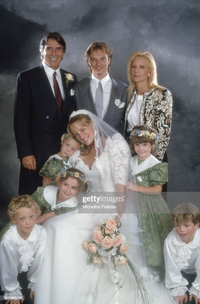 David Hallyday and Estelle Lefebure posing with Sylvie Vartan and Tony Scotti on their wedding day, Saint Martin de Boscherville, France, 15th September 1989