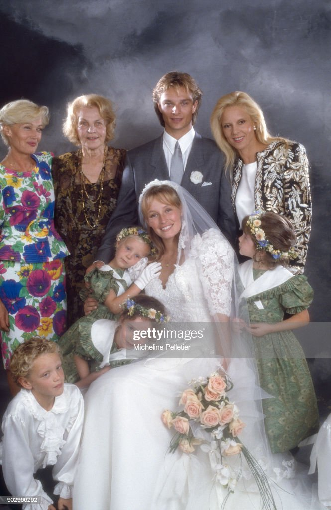 David Hallyday and Estelle Lefebure posing with with Denise Lefebure, mother of Estelle, with David's mother Sylvie Vartan and his gandmother Ilona Vartan on their wedding day, Saint Martin de Boscherville, France, 15th September 1989