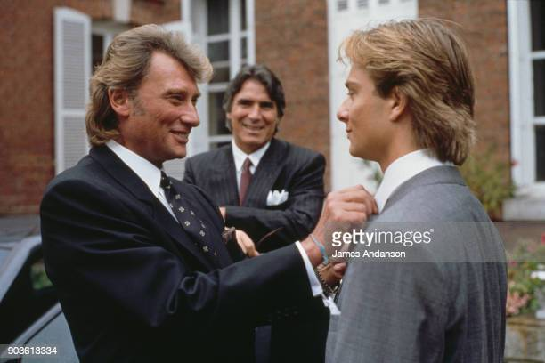 David Hallyday with his father Johnny Hallyday and his fatherinlaw Tony Scotti on his wedding day with Estelle Lefebure in StMartin de Boscherville...