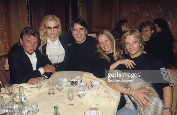 David Hallyday with his parents Johnny Hallyday and Sylvie Vartan his wife Estelle Lefebure and stepfather Tony Scotti after his concert at the...