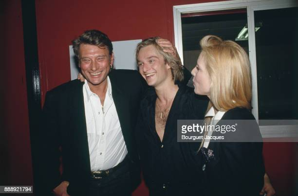 David Hallyday with his parents Johnny Hallyday and Sylvie Vartan, after his concert at the Zenith of Paris, 8th March 1991