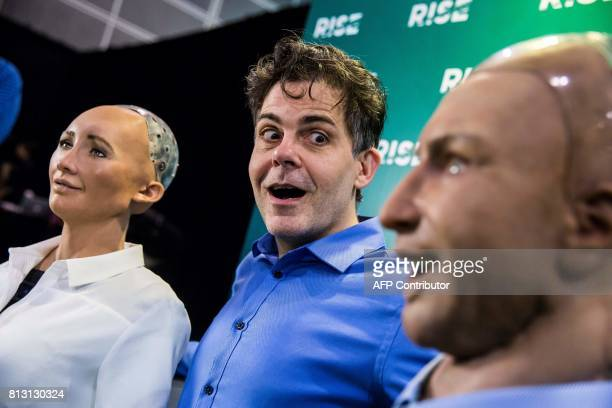 David Hanson chief executive officer of Hanson Robotics reacts to 'Han the Robot' and 'Sophia the Robot' after a discussion about the future of...