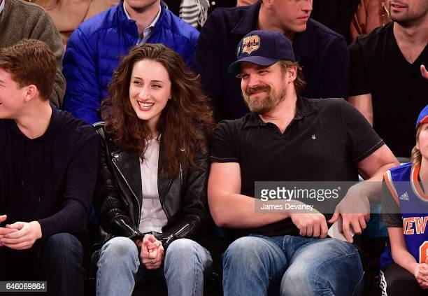 David Harbour and guest attend Toronto Raptors Vs New York Knicks game at Madison Square Garden on February 27 2017 in New York City
