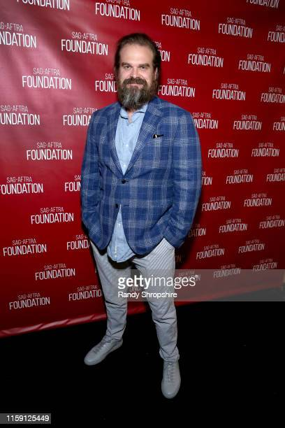 David Harbour attends SAGAFTRA Foundation's sneak preview of Stranger Things 3 on June 29 2019 in Los Angeles California