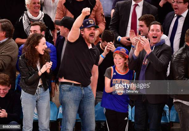 David Harbour Finn Burns and Ed Burns attend Toronto Raptors Vs New York Knicks game at Madison Square Garden on February 27 2017 in New York City
