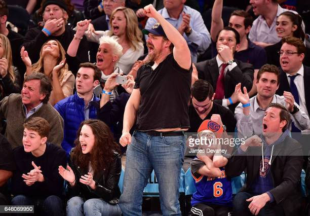David Harbour Finn Burns and Ed Burns attend Toronto Raptors Vs New York Knicks game at Madison Square Garden on February 27 2017 in New York City