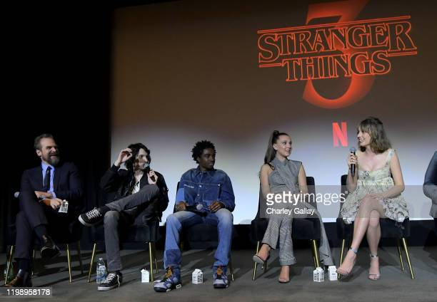 David Harbour Finn Wolfhard Caleb McLaughlin Millie Bobby Brown and Maya Hawke speak onstage during Netflix's Stranger Things QA and Reception at...