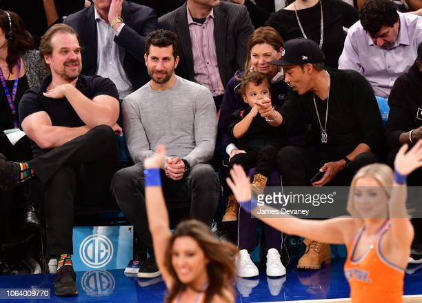 David Harbour guest Ellen Pompeo Eli Ivery and Chris Ivery attend the Portland Trail Blazers vs New York Knicks game at Madison Square Garden on...