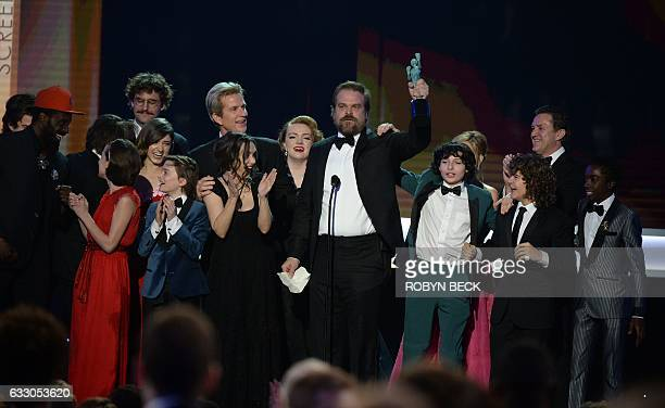 David Harbour holds up the SAG award as he adn the Cast of 'Stranger Things' accept the award for Outstanding Performance by an Ensemble in a Drama...