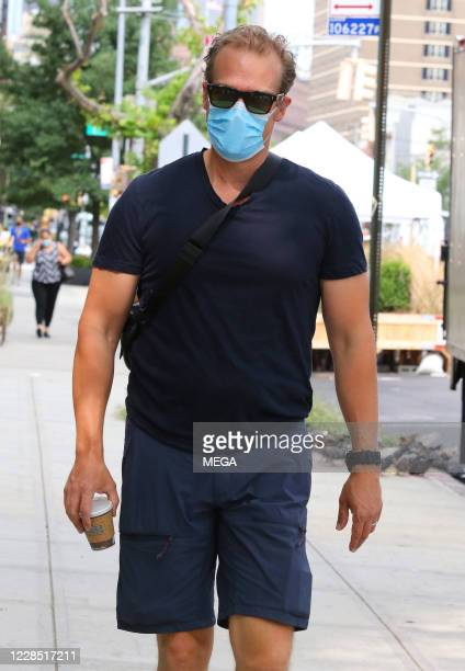 "David Harbour of ""Stranger Things"" walks wearing a mask on September 14, 2020 in New York City, New York."