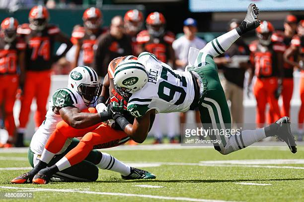 David Harris and Calvin Pace of the New York Jets take down Luke Lundy of the Cleveland Browns during the game at MetLife Stadium on September 13,...