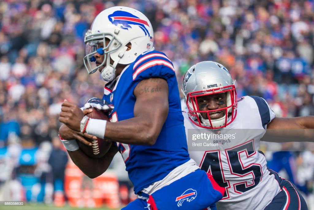 David Harris #45 of the New England Patriots tackles Tyrod Taylor #5 of the Buffalo Bills on the first play of the game during the first quarter at New Era Field on December 3, 2017 in Orchard Park, New York. New England defeats Buffalo 23-3.