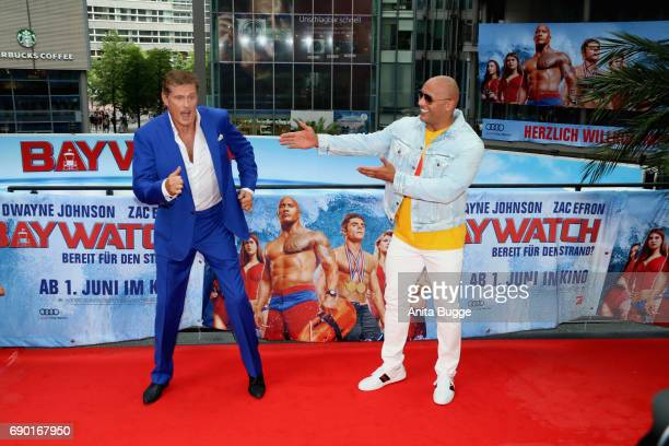 David Hasselhoff and actor Dwayne Johnson attend the 'Baywatch' photocall in Berlin on May 30 2017 in Berlin Germany