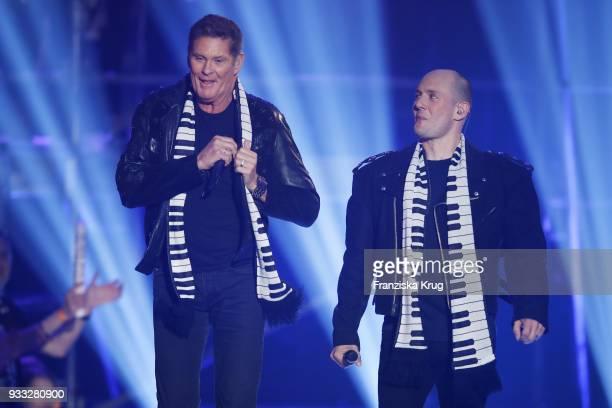 David Hasselhoff and Oli P perform during the TV show 'Heimlich Die grosse SchlagerUeberraschung' on March 17 2018 in Munich Germany