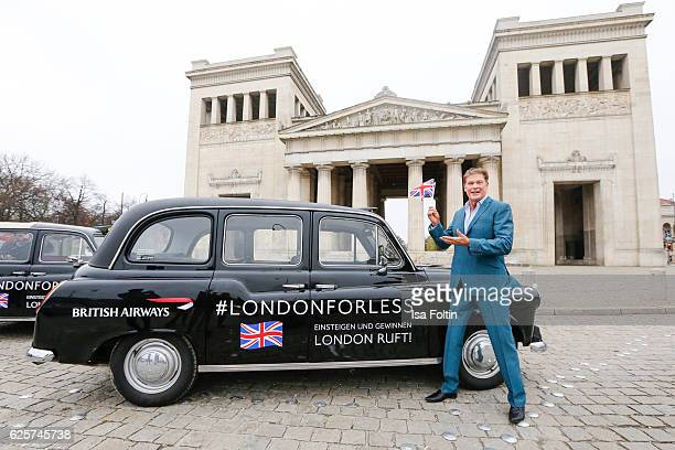 David Hasselhoff poses near an uBA London taxi during a competition to launch the British Airways London for Less Sale on November 25, 2016 in...